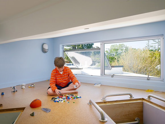 A loft playroom accessible from two children's bedrooms