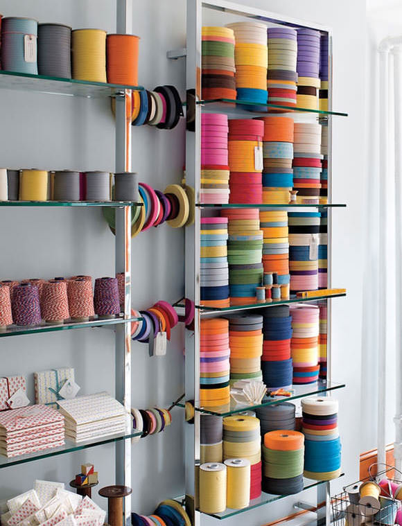 Colorful & organized crafts supplies in bookmaker's studio