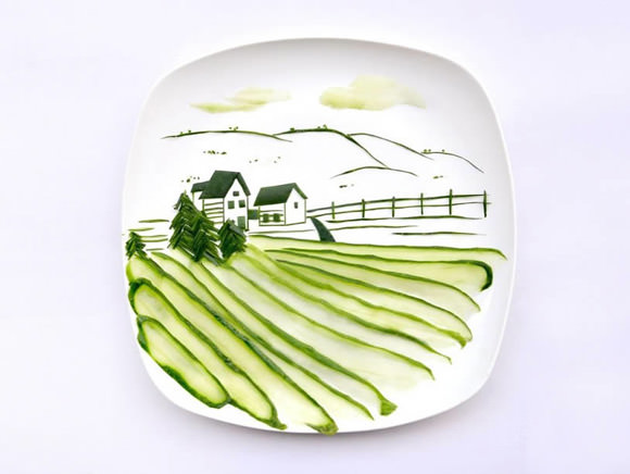 Landscape scene made from a single cucumber by Hong Yi