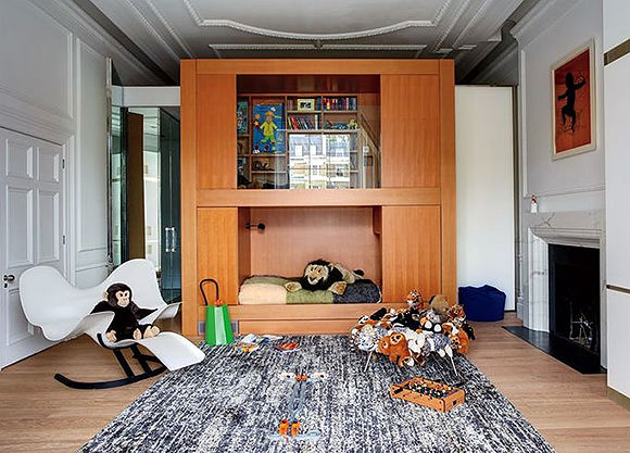a children's bed / library unit bunk combo