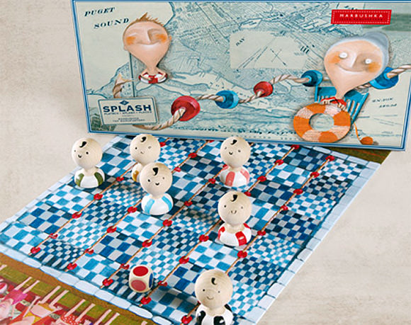 Splash, a handmade take on checkers  with little wooden swimmers