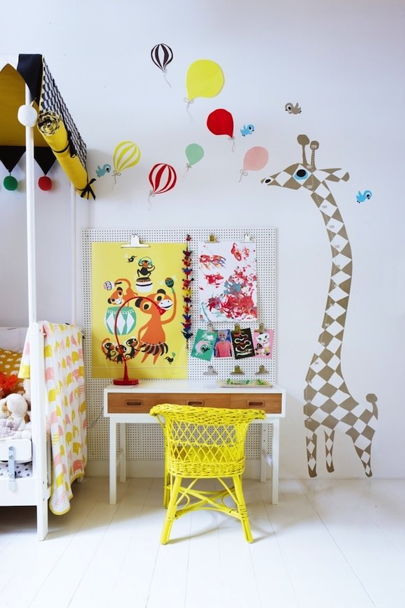 minimal kids room with bright pop of color via yellow painted rattan child's chair