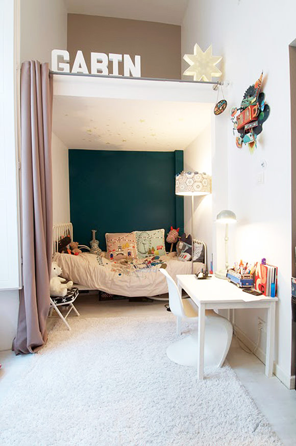 If you don't want to invest in custom bunk beds, just add some curtains to a nook and let your little ones have their own private suite.