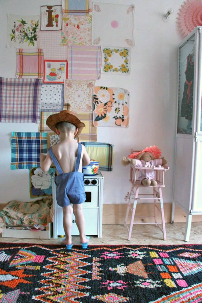 Decorating the kid's room wall with fabric remnants