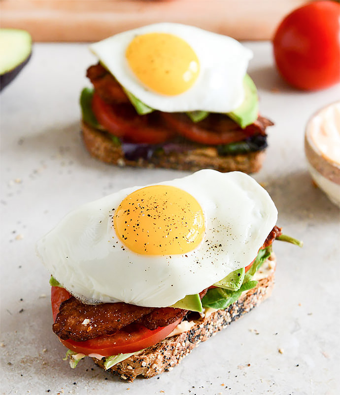 Breakfast Sandwich Recipe: Avocado BLT with Spicy Mayo and Fried Eggs (via How Sweet It Is)