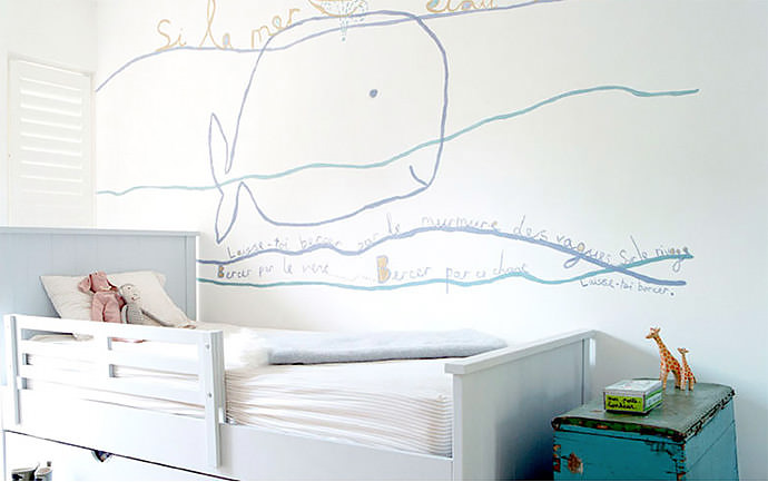 Delightful hand-painted mural in a kid's room by Jane Reiseger