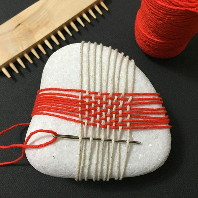 Weaving Stones, image via Paseando Hilos